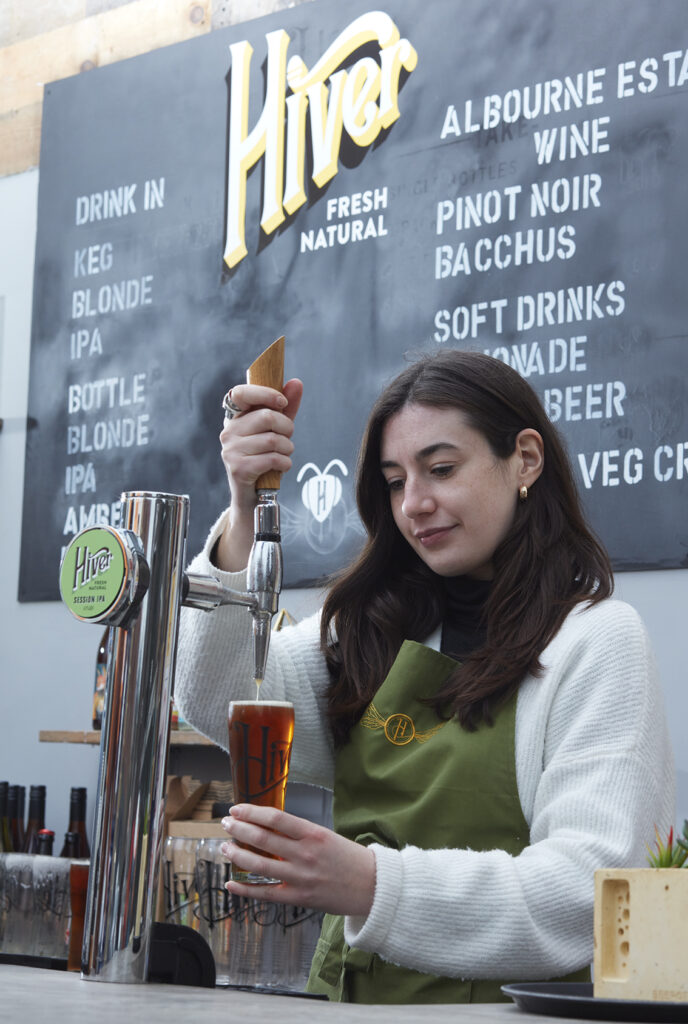 Pouring a beer at hiver taproom